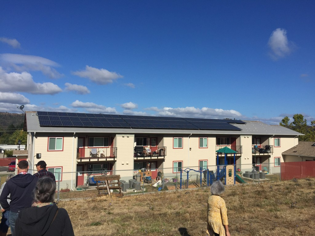 Tour-goers check out a new solar installation at one of UCAN's affordable housing developments.